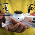 A child's hands holding an assembled DIY Drone. To fly the drone download the app with the app you can easily fly it. Also able to record videos and take photos with the drone while using the app.