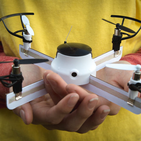 A child's hands holding an assembled DIY Drone.