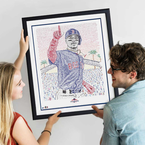 Female and male best friends smile at each other and hang framed word art portrait of Mookie Betts on the wall.
