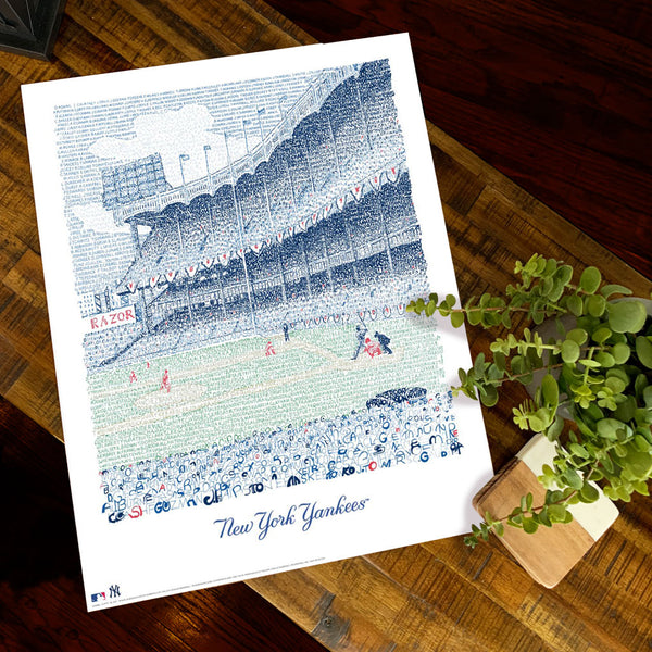 Unframed print of Yankee Stadium word art, handwritten with New York Yankee's all-time roster, lies flat on wooden table.