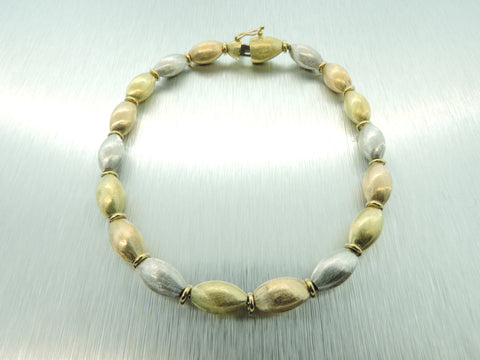 14 KT TRI-COLOUR GOLD TEXTURED PEBBLE BRACELET
