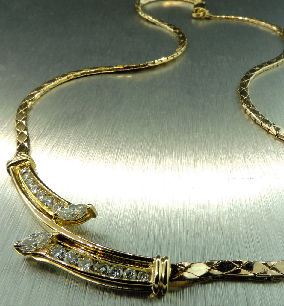 V DESIGN NECKLACE IN 14 KARAT YELLOW GOLD WITH 1.06 CT. DIAMONDS