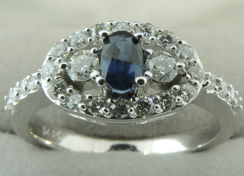 HALO SETTING DIAMOND AND BLUE SAPPHIRE ENGAGEMENT RING