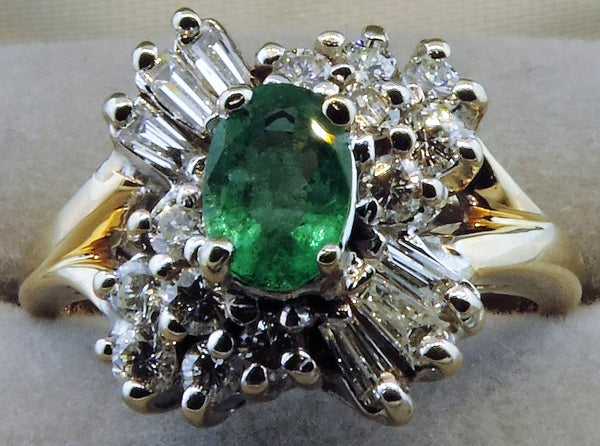 OVAL EMERALD AND DIAMOND CELEBRATION CLUSTER RING