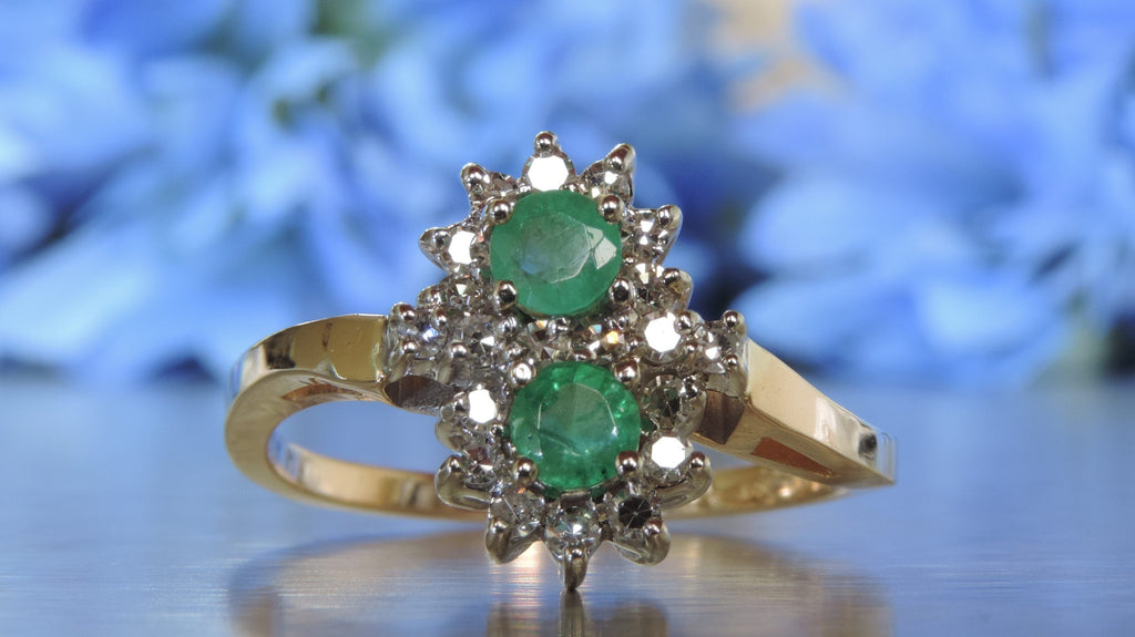 DOUBLE CLUSTER DIAMOND AND EMERALD RING