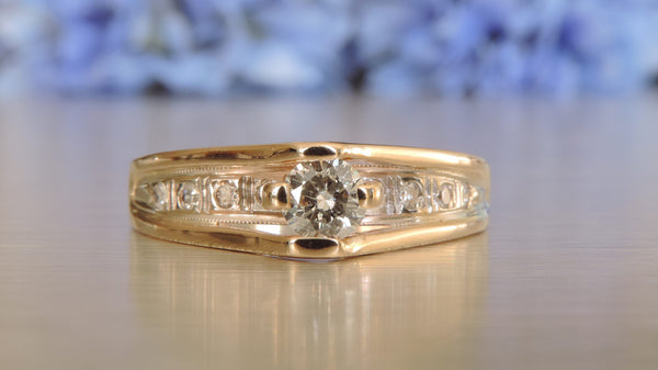 HALF ETERNITY DIAMOND RING WITH ROUND BRILLIANT CENTRE