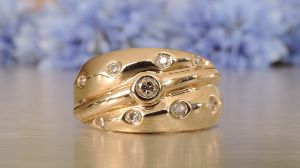 ROUNDED BAND RING WITH SCATTERED DIAMONDS
