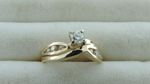 SWIRL CHANNEL ENGAGEMENT AND WEDDING RING SET