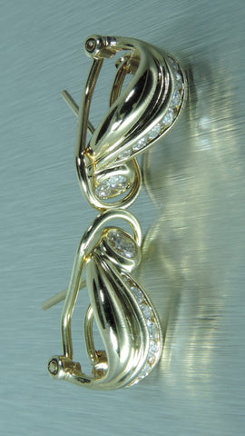 SWIRL DESIGN CHANNEL AND BEZEL SET DIAMOND EARRINGS