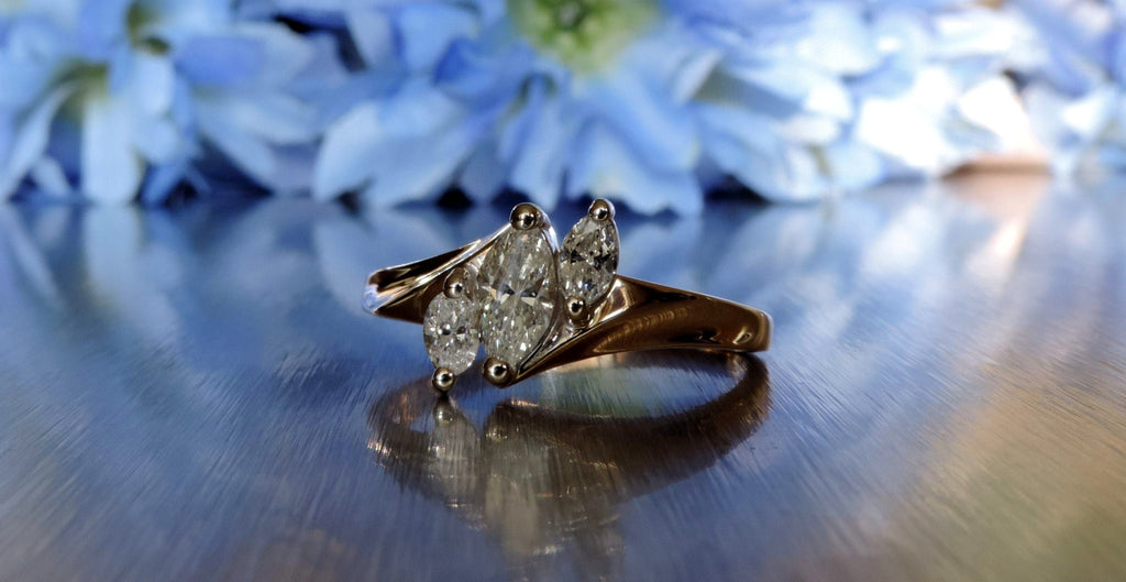 THREE STONE MARQUISE CUT DIAMOND ENGAGEMENT RING