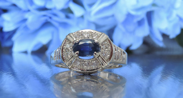 VINTAGE-INSPIRED BLUE SAPPHIRE AND DIAMOND ENGAGEMENT RING
