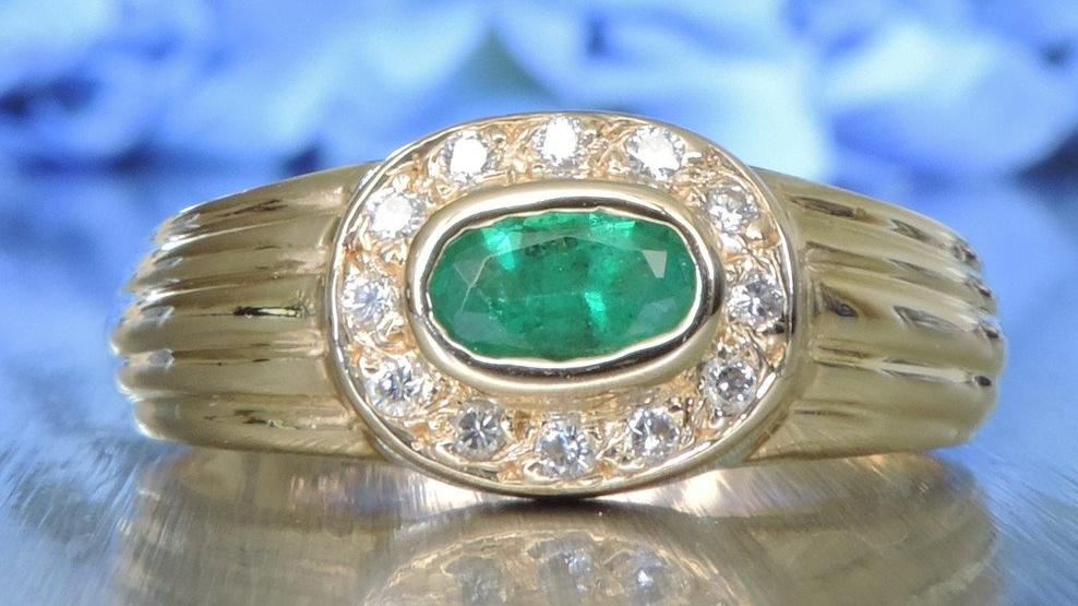DIAMOND AND EMERALD OVAL CLUSTER RING
