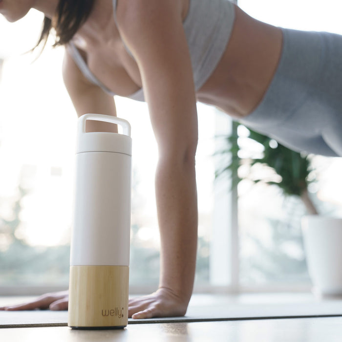 White Adventure Bundle, fit woman holds a plank next to white water bottle