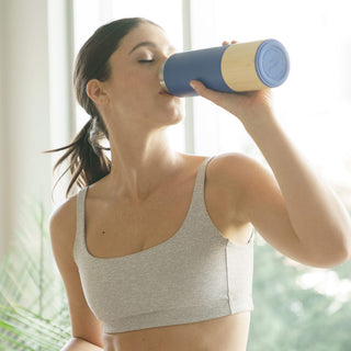 Blue Adventure Bundle, fit young woman in gray sports bra sips from blue water bottle