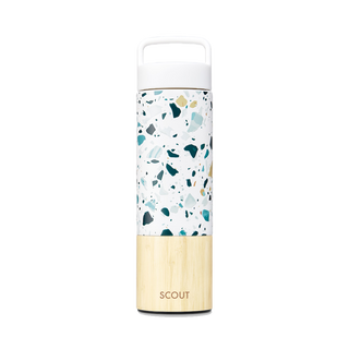 Tall terrazzo water bottle with bamboo base and the name Scout engraved on the side