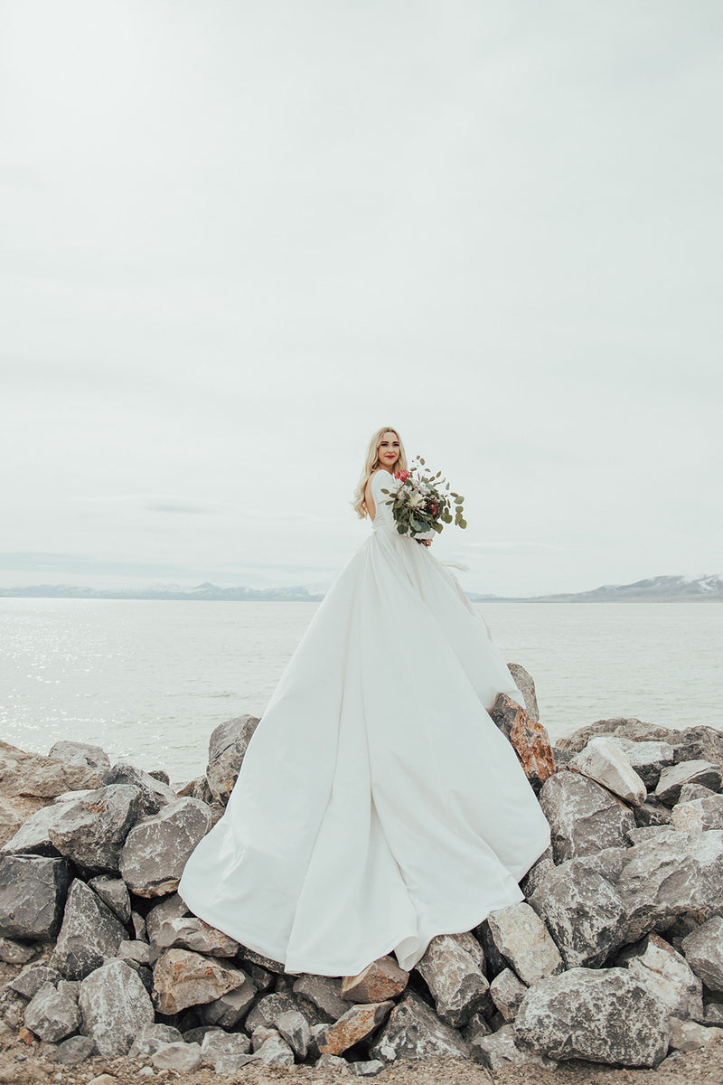 Margot | Long Sleeve Stretch Crepe Low Back Wedding Dress with Full Satin Ball Gown Skirt with Pockets