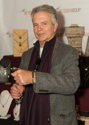Tony Dennison wearing grey stone bracelet by Wallis Designs