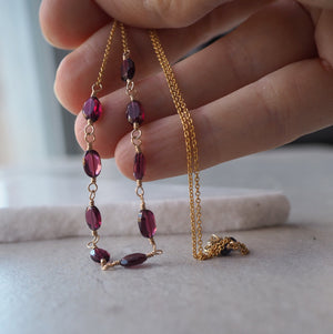 Gold and garnet gemstone necklace with delicate chain