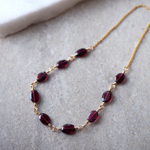 Delicate gemstone necklace with garnet and gold