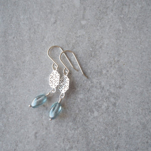 Sterling Silver Drop Earrings with light blue glass