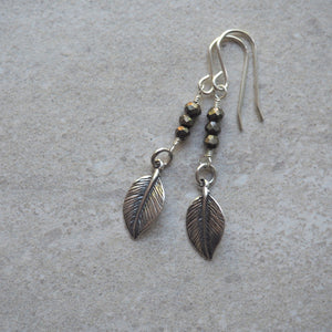 Long sterling silver earrings with silver leaf and gemstones