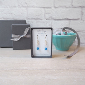 Infinity Earrings with Blue Gemstone by Nancy Wallis Designs