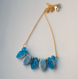 Blue Leaves Gold Necklace by Nancy Wallis Designs