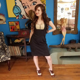 Woman sassy look black dress brown and ivory dance heels