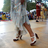 Closeup of woman wearing Aris Allen Brown and Ivory dance heels