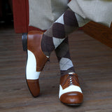 Closeup of Aris Allen Brown and Ivory Saddle Shoes