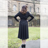 Woman black vintage dress mermaid hair black heels dance shoes