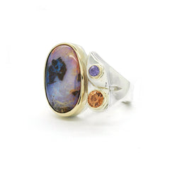 large oval opal ring with gold and sterling silver