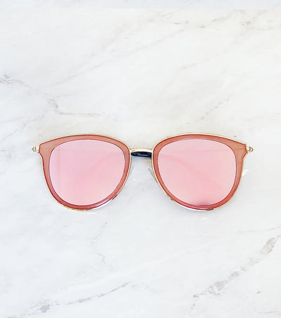 Pink mirrored lenses on pink and gold sunglasses