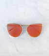 orange cat eye sunglasses with gold wire frame