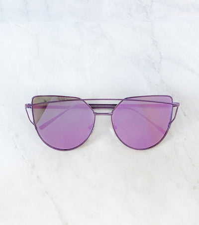 Sunglasses with purple frame and purple lenses
