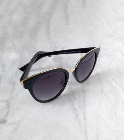 gold brow and bridge on black sunglasses