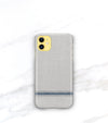 yellow iphone 11 in a blue and gray stripe phone case with matte finish