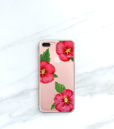 Hawaiian Tropic Clear Case over a rose gold iPhone