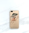 Jellyfish Clear case over a gold iPhone