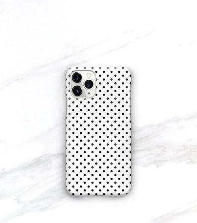 black dots on a white iphone 11 pro case in a matte finish