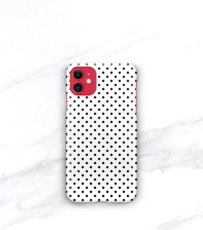 black and white polka dots case on a red iphone 11