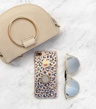 neutral ring bag with leopard print iPhone case and sunnies