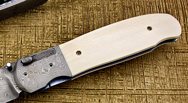 Ricke, Dave - Ivory D/A Automatic and Manual - LinerLock Folder