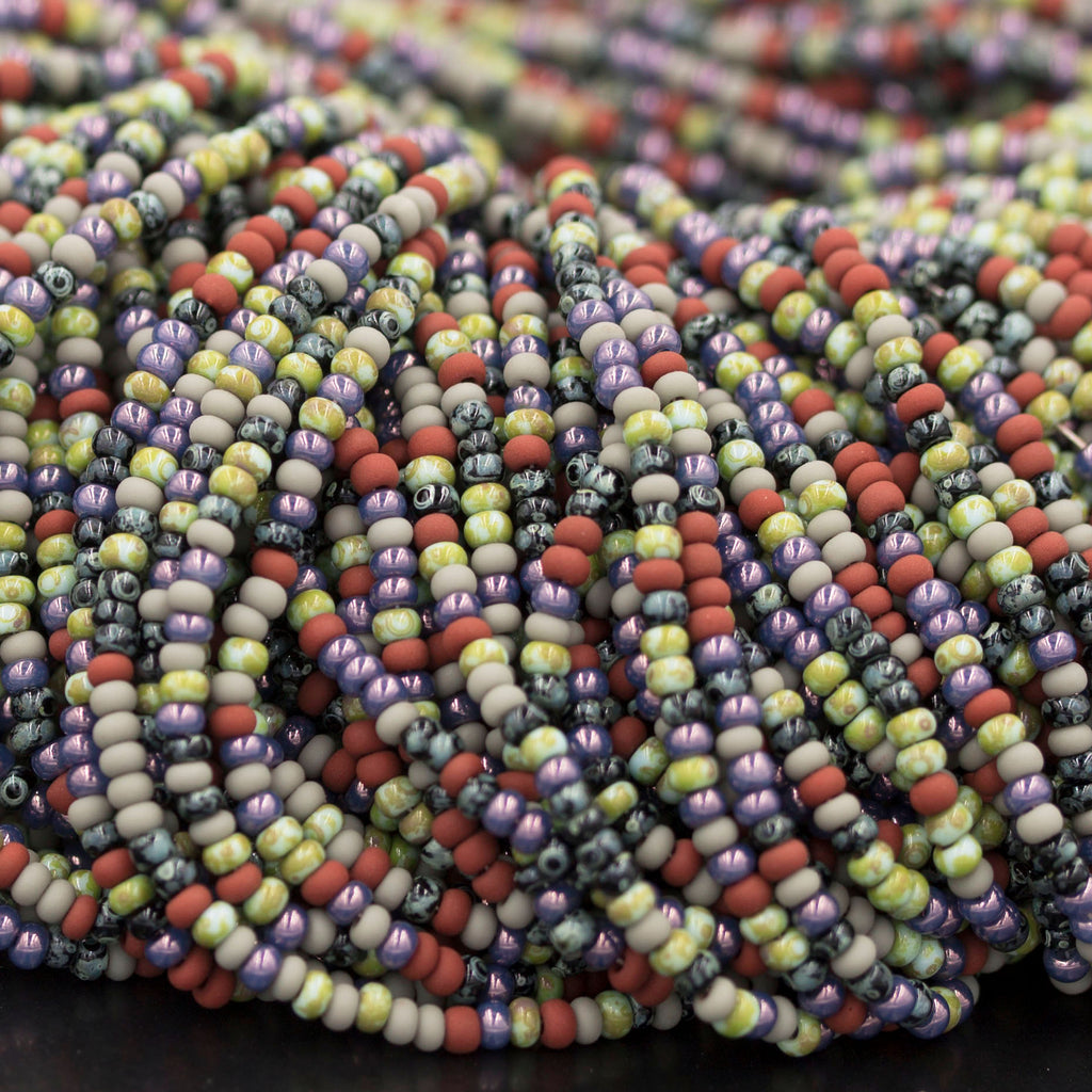 "(2) 20.5"" Strands 10/0 (2.3mm) Aged Moirai striped Picasso seed beads, 650 beads"