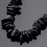 One strand of 50 pebble sea glass beads, 6 - 20mm, Black