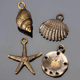 4 Sea shell charm mix, Antique brass