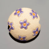 Golem Studios handmade carved purple flowers ceramic lentil, 22mm