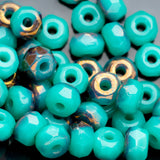 50 Turquoise green opaque with bronze firepolished rondelle seed beads, 3 x 2mm