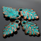 4 Green patina cast leaf charms, 20 x 12mm