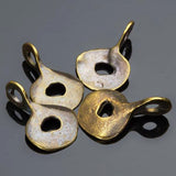 4 Cast doodad charms in antique brass, 18 x 11